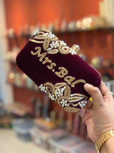 Customized embroidered velvety clutches photo review